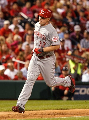 Cincinnati Reds' Jay Bruce rounds the bases after hitting a home run during the fourth inning of a baseball game against the St. Louis Cardinals on Sunday, Sept. 21, 2014, in St. Louis.