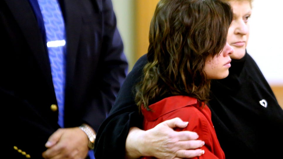 Roksana Sikorski 15, of Plymouth Township, stands with her attorney Leslie Posner before a 35th District courtroom Thursday, Oct. 23, 2014.