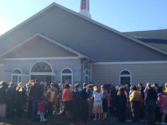 Members of Tabernacle Baptist Church in Tioga, Pa. gather outside their new church building April 12 for a ribbon-cutting ceremony.