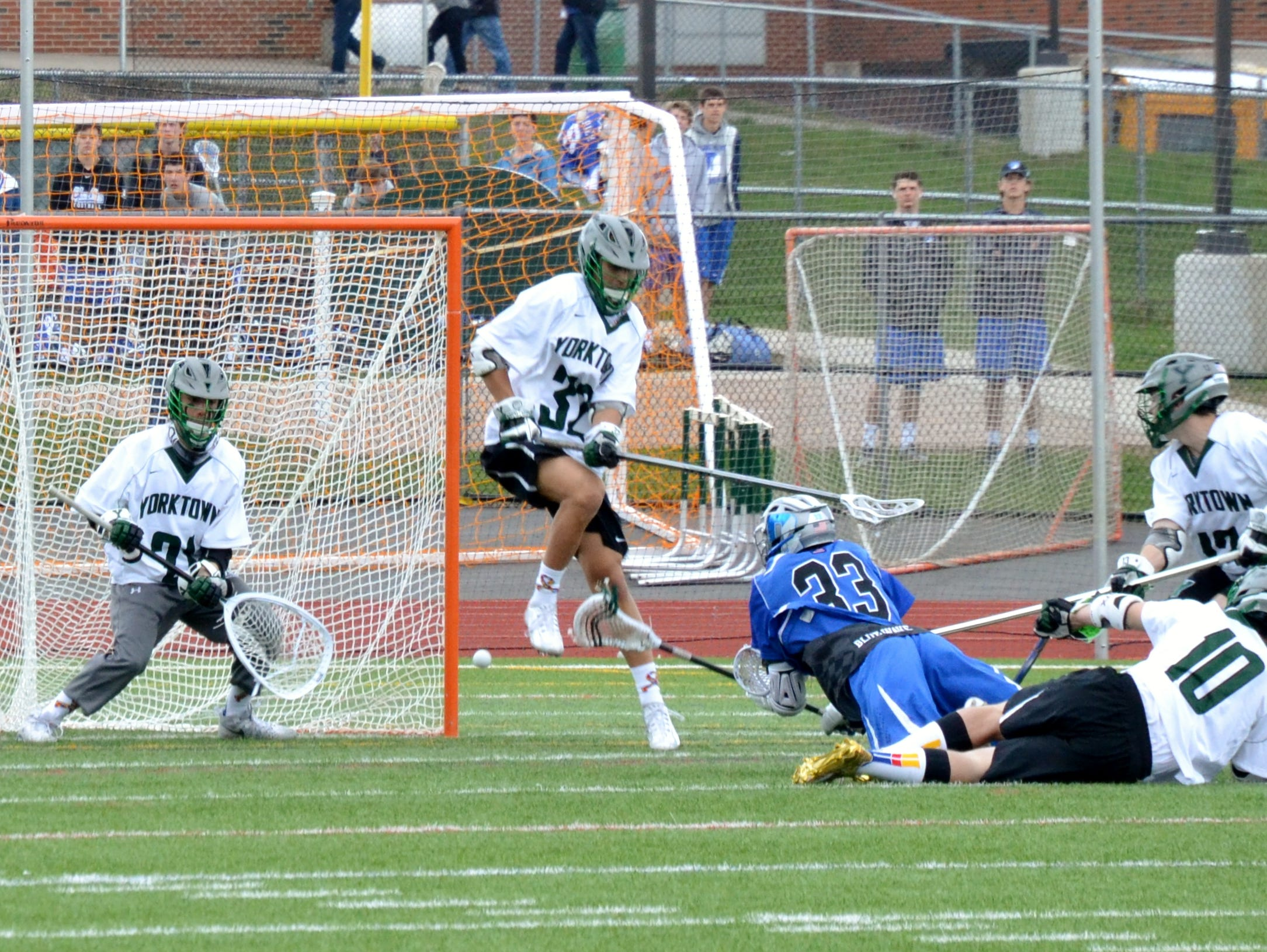 Yorktown goalie Liam Donnelly lines up a shot from Darien attackman Kevin Lindley in the second half of the Huskers' 12-3 loss on Saturday.