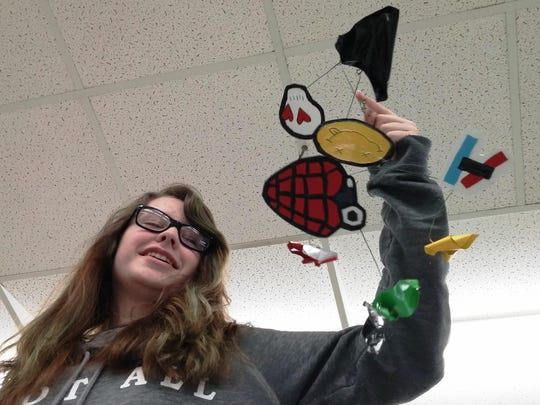 Fort Braden student with her individual mobile.