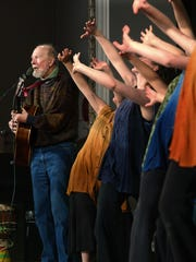"""Pete Seeger sings """"Turn! Turn! Turn!"""" as dancers from Vanaver Caravan perform during at benefit concert for Two Farms at Studley Hall at SUNY New Paltz in  2006. The New Paltz-based Vanaver Caravan dance troupe has been receiving NEA funding since 1973."""