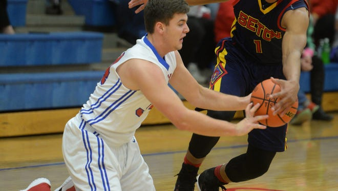 Union County's Haidyn Lathery tries to move the ball away from Seton Catholic's Desmond Bane during a basketball game Tuesday, Dec. 1, 2015, in Liberty.