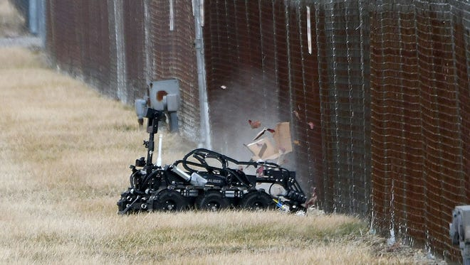 A remote controlled robot detonates a suspicious package on Thursday afternoon at the fence perimeter of the Columbia Gas Transmission Lucas Operations facility on Ohio 39 between Lucas and Loudonville. The  black and maroon gift-wrapped box, which was addressed from one company to another, proved to be empty. The Richland County Sheriff's office, Ashland County Sheriff's Office bomb squad, Lucas-Monroe Township Fire Department and Columbia Gas officials were at the scene. A remote controlled robot detonates a suspicious package on Thursday afternoon at the fence perimeter of the Columbia Gas Transmission Lucas Operations facility on Ohio 39 between Lucas and Loudonville. The  black and maroon gift-wrapped box, which was addressed from one company to another, proved to be empty. The Richland County Sheriff's office, Ashland County Sheriff's Office bomb squad, Lucas-Monroe Township Fire Department and Columbia Gas officials were at the scene.