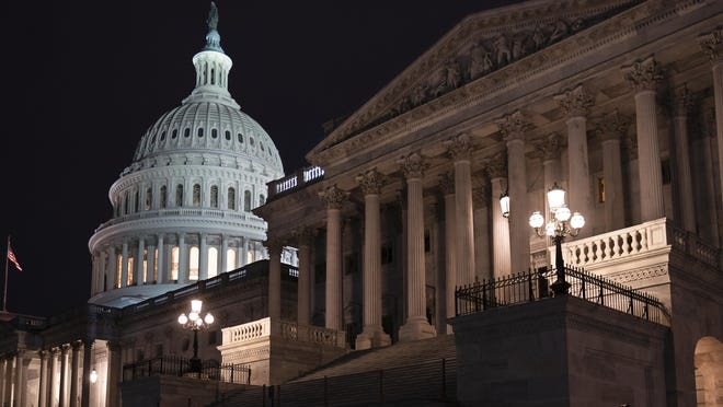 The Senate is seen as the impeachment trial of President Donald Trump is set to resume at the Capitol in Washington, Friday, Jan. 31, 2020. (AP Photo/J. Scott Applewhite)
