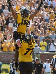 Missouri Toffensive lineman Paul Adams, bottom, lifts running back Damarea Crockett in the air after Crockett scored a touchdown during the first quarter of an NCAA college football game against Missouri State Saturday, Sept. 2, 2017, in Columbia, Mo. (AP Photo/L.G. Patterson)