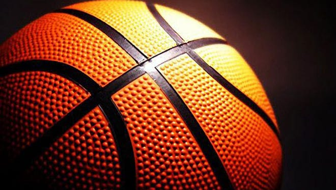 A former Carmel middle school basketball coach has sued the school district for wrongful termination.