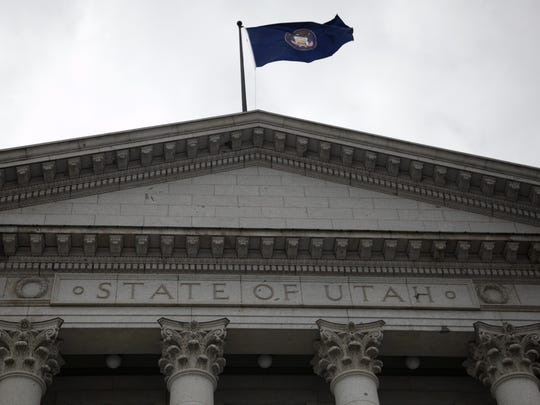 The Utah State Flag flies above the Utah State Capitol Building in this file photo.