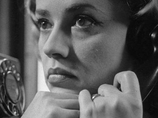 "Many of the events of Louis Malle's feature debut are related through close-ups of Jeanne Moreau's face. Here she makes another attempt to contact her lover, unaware he's trapped in an ""Elevator to the Gallows."""