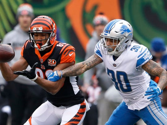 Detroit Lions cornerback Teez Tabor (30) knocks the ball away from Cincinnati Bengals wide receiver Tyler Boyd (83) during the first half of an NFL football game, Sunday, Dec. 24, 2017, in Cincinnati.