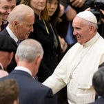 Pope Francis shakes hands with U.S. Vice President Joe Biden as he takes part at a congress on the progress of regenerative medicine and its cultural impact, being held in the Pope Paul VI hall at the Vatican,  Friday, April 29, 2016.