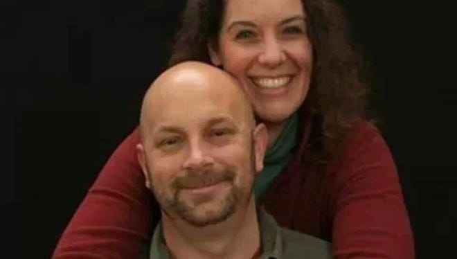 It came as no surprise to Michael Landsberry's family that the Sparks Middle School math teacher is being called a hero for trying to get a student to put his gun down before being shot and killed on Monday, Oct. 20, 2013 at the Sparks, Nev. school. He is shown with Sharon Landsbery in this family photo.