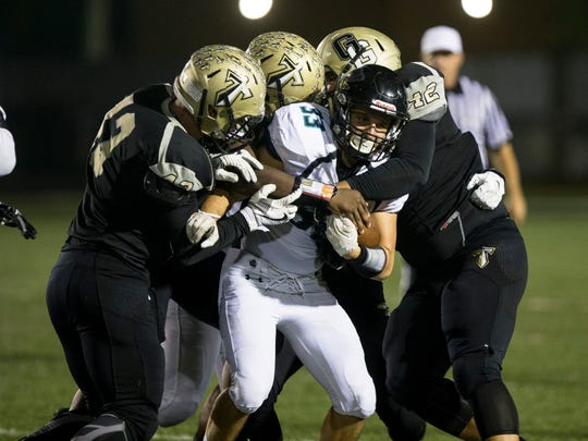 Golf Coast wide receiver Elvis Circi (33) tries to break a tackle against the Titan defense at Golden Gate High School on Friday, Nov. 4, 2016. The Sharks defeated the Titans 28-7.