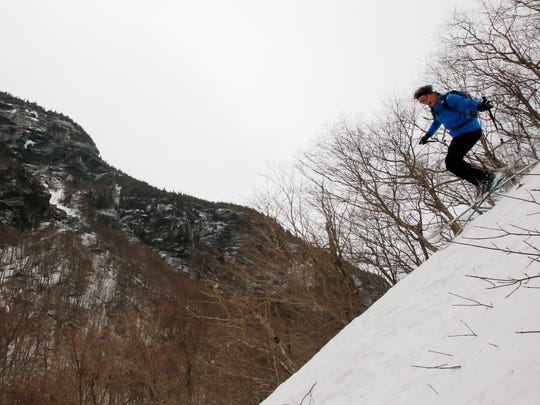 The condition of Pete Davis' commute varies by the day: Last winter he skied to and from his job at Stowe Mountain Resort over the closed Smugglers Notch Road.