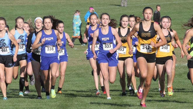Benton's girls cross country team starts strong at the WaMaC championship held Thursday, Oct. 13, at Solon. Leading the race is Center Point-Urbana's Adrianna Katcher. Sophia Gilbert placed second for Benton.