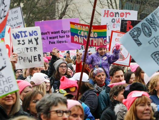 A crowd cheers Sunday, Jan. 21, 2018, during 2018 Women's