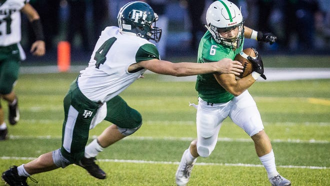 FILE -- New Castle's Tytus Ragle runs the ball against Pendleton Heights during their game at New Castle High School on Aug. 31, 2018.