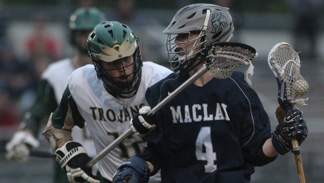 Maclay's Stone Foster tries to keep the ball away from Lincoln defender Quinton Thomas.