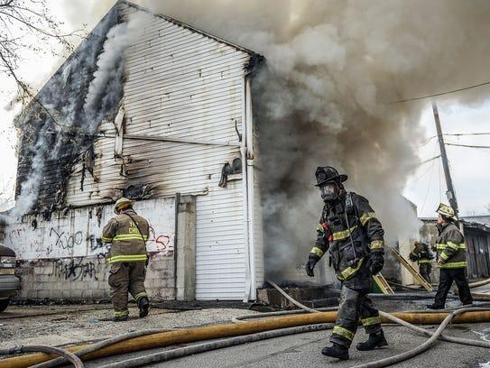 York City Firefighter Ivan Flanscha walks out of a