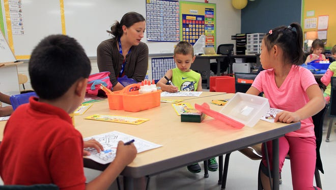 Tiffin Elementary kindergarten teacher Christina Pfab chats with students on the first day of school on Tuesday, Sept. 1, 2015. The new school is quickly filling and could be above capacity within three years, Clear Creek Amana officials say.
