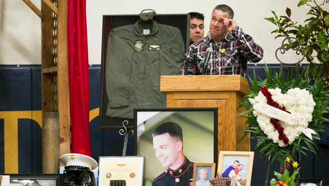 Brian Lulay, a friend of the Hart family, salutes for his friend Ty Hart at a memorial service for Hart at Stayton High School on Saturday, Jan. 30, 2016. Lance Cpl. Hart was one of the 12 Marines who died Jan. 14 when two military helicopters collided during training exercises in Hawaii.