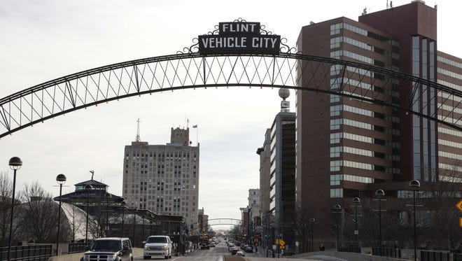 A view of Saginaw Street leading into downtown Flint on Wednesday January 6, 2016.