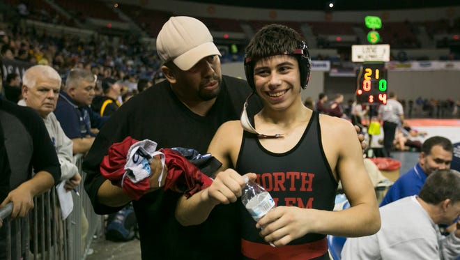 North Salem's Ian Carlos smiles after winning his match against David Douglas' Kyle Beal at the OSAA state wrestling tournament on Friday, Feb. 26, 2016, at Memorial Coliseum in Portland, Ore.
