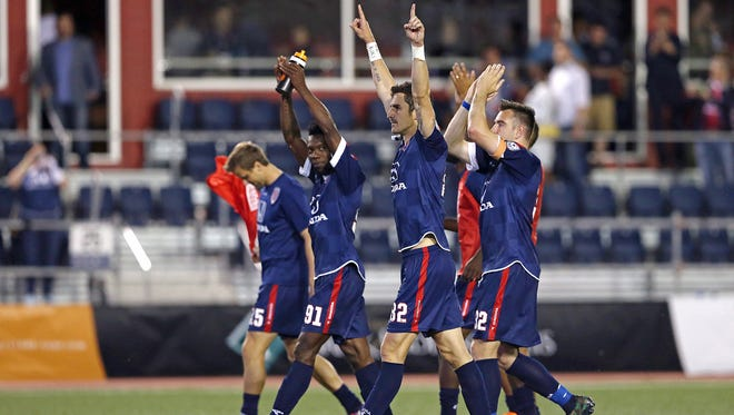 The Indy Eleven celebrate its 4-2 win over Minnesota United FC and the continuation of their undefeated status, at IUPUI's Carroll Stadium, Indianapolis, Saturday, May 21, 2016.