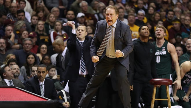 Michigan State coach Tom Izzo reacts against the Minnesota during the second half of MSU's 75-74 overtime win over Minnesota Tuesday in Minneapolis.