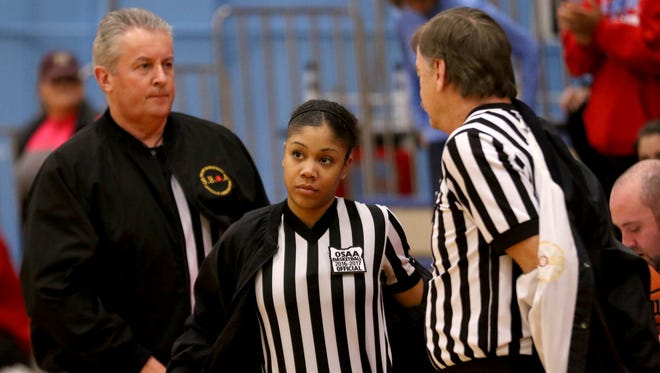Brihtani Lassiter, center, Brian Florip, left, and Charlie Goodman prepare to work the McNary vs. South Salem girl's basketball game at South Salem High School on Tuesday, Jan. 17, 2017. The Salem Basketball Officials Association has increased from two referees to three for 4A, 5A and 6A boys and girls basketball games this season.