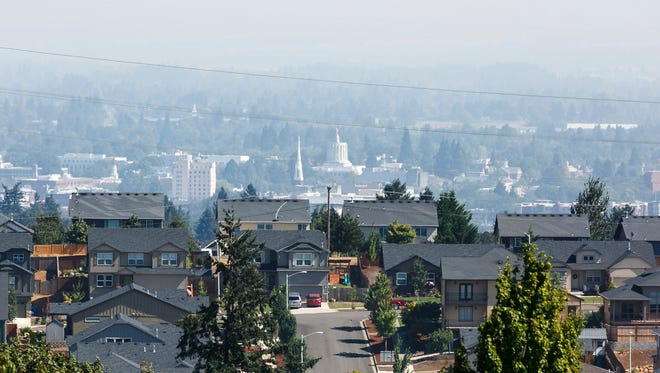 Smokey skies are visible over Salem from Eola Drive NW on Monday, Sept. 11, 2017.