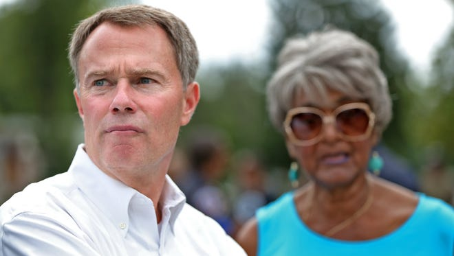 Mayor Joe Hogsett looks at a neighborhood during a community walk, Wednesday, Sept. 27, 2017.