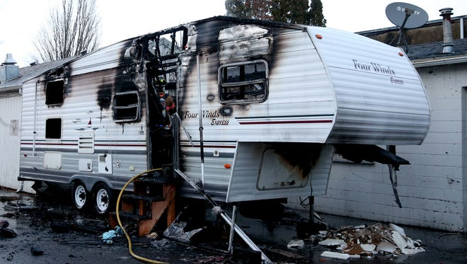 A trailer fire on Market St. NE between Commercial and Liberty St. NE in Salem on Tuesday, Dec. 19, 2017.