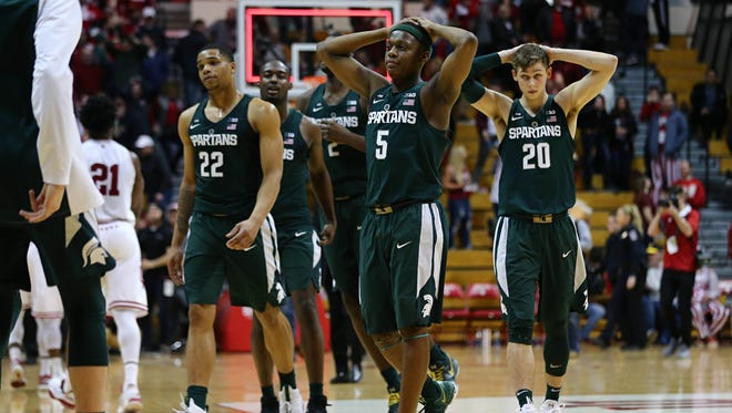 The Michigan State Spartans react after defeating the Indiana Hoosiers at Assembly Hall, Saturday, Feb. 18, 2018.