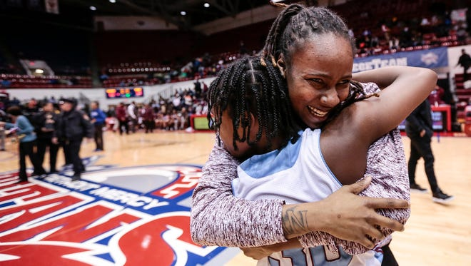 Mumford assistant coach Erica Powell hugs Brooklyn Taylor (30) after defeating Renaissance 60-58 in the Detroit Public School League championship game at University of Detroit Mercy in Detroit, Friday, February 16, 2018.
