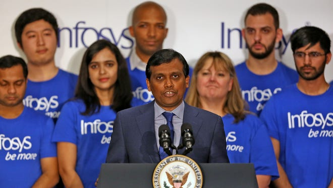Infosys President and Deputy COO Ravi Kumar speaks during the Infosys announcement event, Thursday, April 26, 2018.  Infosys announced plans to build a U.S. education center as part of a $245 million campus near the Indianapolis International Airport, providing up to 3000 jobs.