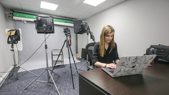 Brittany Lodge, a video production specialist, works in the multimedia studio at the Bailey & Wood Financial Group's offices in Whiteland, Ind., on April 26, 2018.