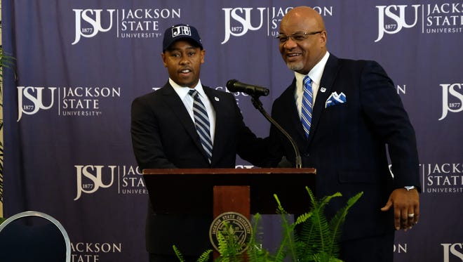 Jackson State President William Bynum (right) introduced Ashley Robinson (left) as the next athletic director Tuesday at the JSU Student Center in Jackson.