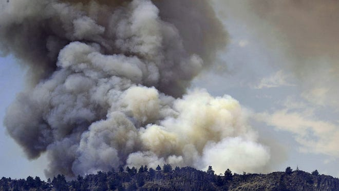 Smoke from the Klamathon Fire billows skyward Friday as the blaze races toward the California-Oregon state line.