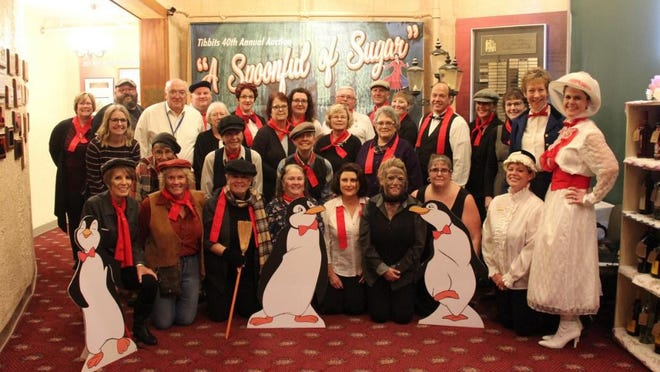"""2019 Tibbits auction volunteers and staff dressed as chimney sweeps and various Mary Poppins characters for """"A Spoonful of Sugar."""" This year's auction, """"Clue! The Game is On!"""" will feature five days of online silent and live auctions from Nov 3-Nov 7."""