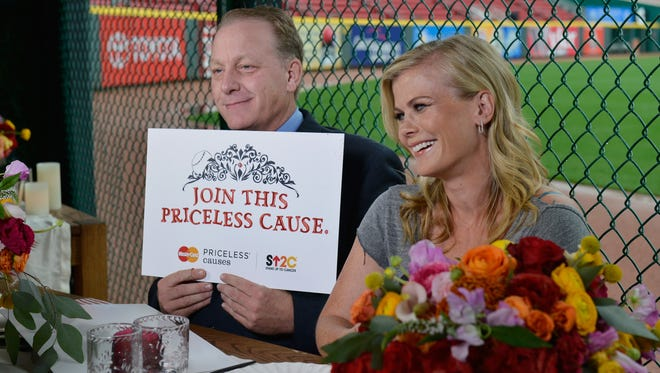 Curt Schilling, left, and Alison Sweeney kick off the MasteCard Stand Up to Cancer dining program at Great American Ball Park in Cincinnati.