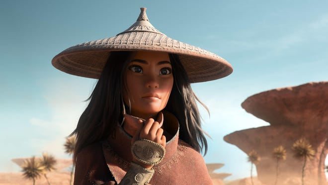"""The lone warrior Raya (voiced by Kelly Marie Tran) ventures to find to the legendary last dragon and stop the villainous Druun in """"Raya and the Last Dragon."""""""