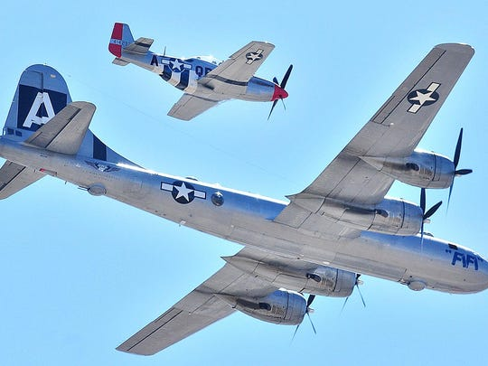 A P-51 Mustang escorts a B-29 Superfortress bomber.