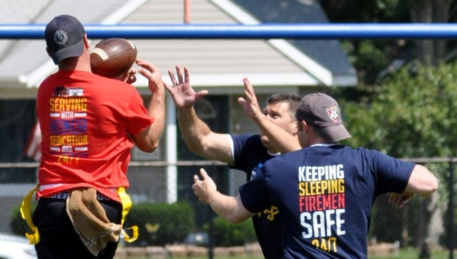 Members of the police and fire teams battle for a pass.