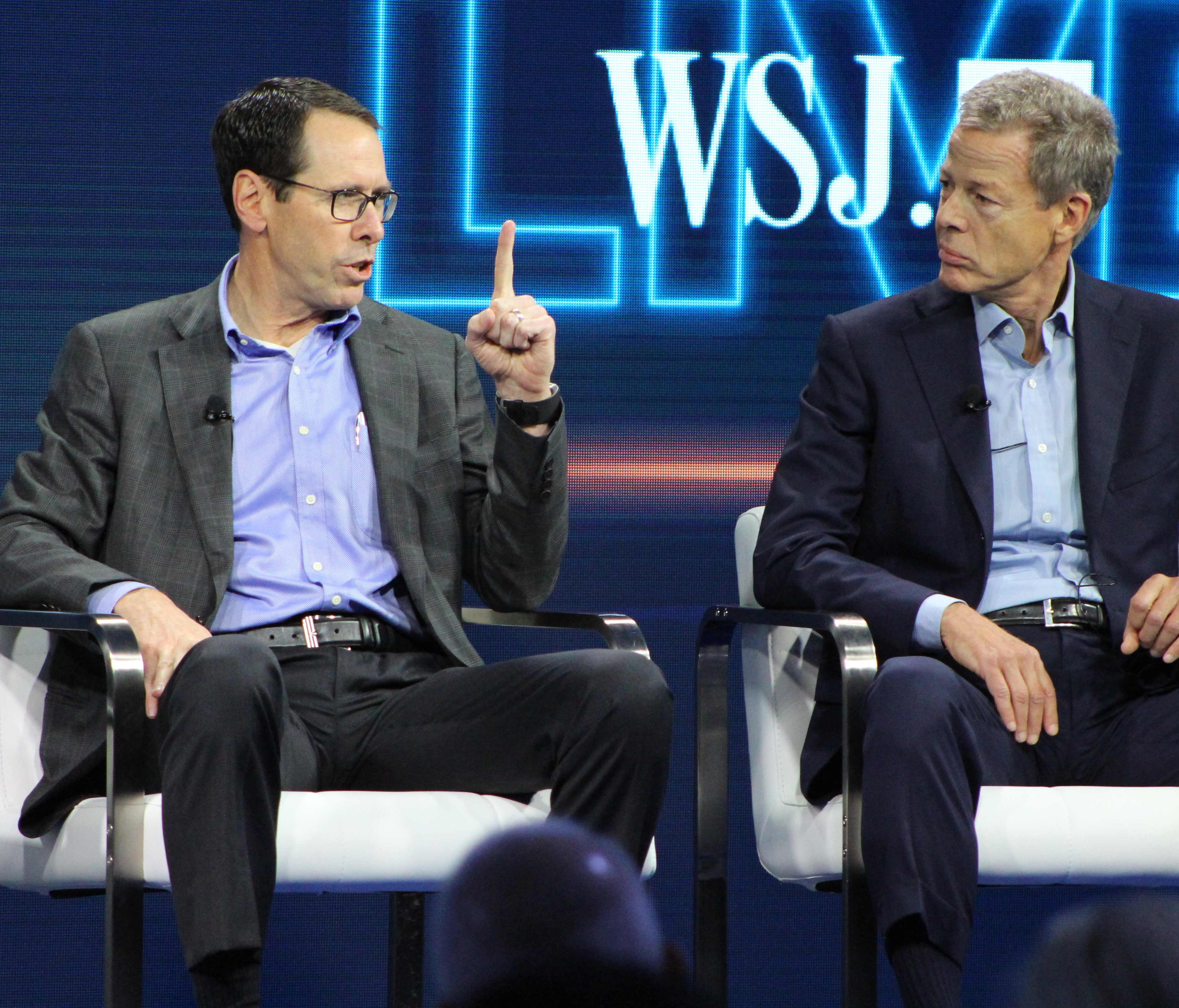 AT&T chief executive Randall Stephenson, left,  and Time Warner chief executive Jeffrey Bewkes defend the proposed mega-merger of the companies at a WSJD Live technology conference in Laguna Beach, Calif., on Oct. 25, 2016.
