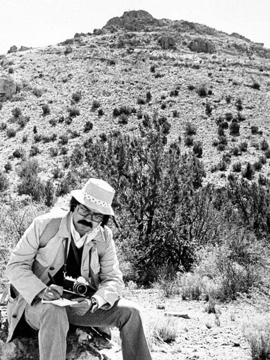 Rentería jotting notes during a visit to Victorio Peak, N.M., in the late 1970s.