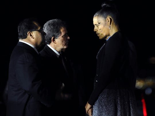 President Obamaand First Lady Michelle Obama are greeted