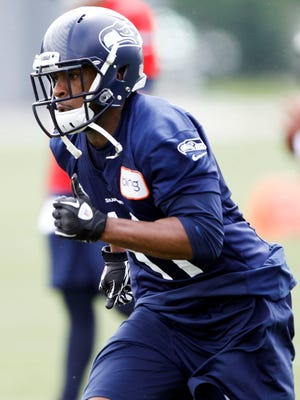 Seattle Seahawks wide receiver Percy Harvin (11) participates in organized team activities at the Virginia Mason Athletic Center in Seattle on May 20, 2013.