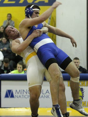 Buena's Ty Warren tries to take down Hammonton's Brandon Beebe during the 2012-13 season. Warren was an accomplished mini wrestler, but only competed his senior year in high school because he needed to get away from the sport.