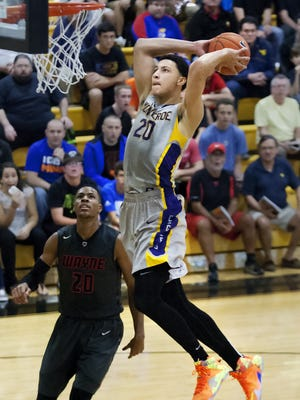 Montverde Academy's Ben Simmons scores against Huber Heights (Ohio) Wayne during the 42nd annual Culligan City of Palms Classic on Friday  at Bishop Verot High School. Simmons is considered the top high school player in the country.
